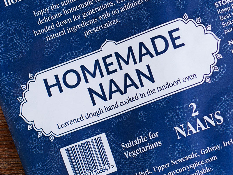 Close-up of Curry and Spice naan bread packaging.